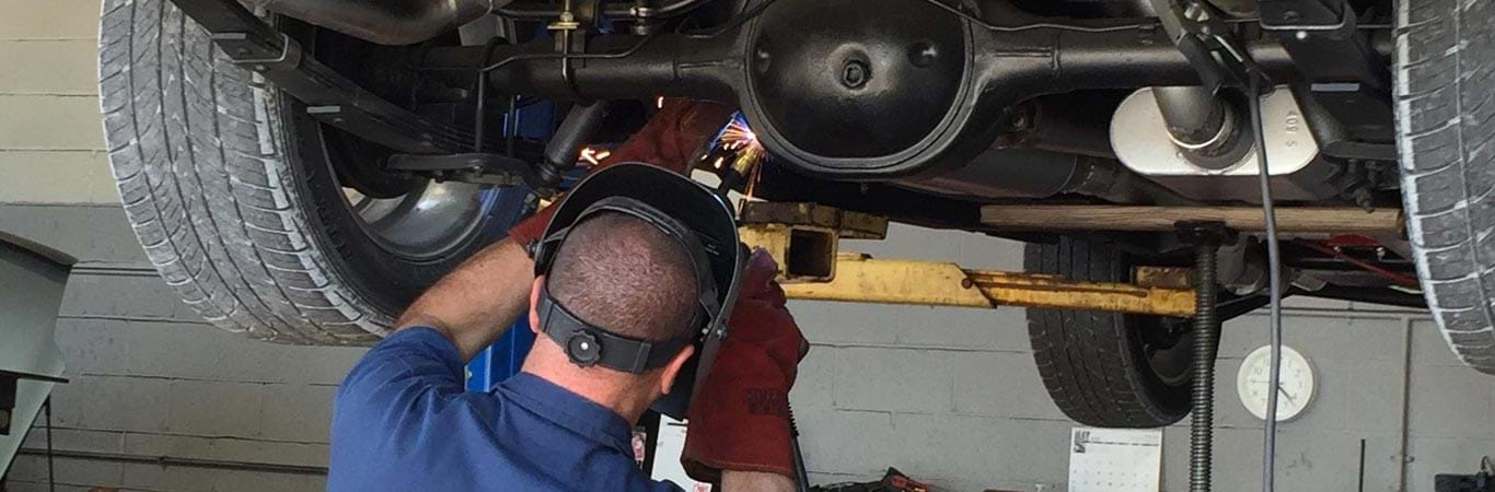 mechanic welding something in your car